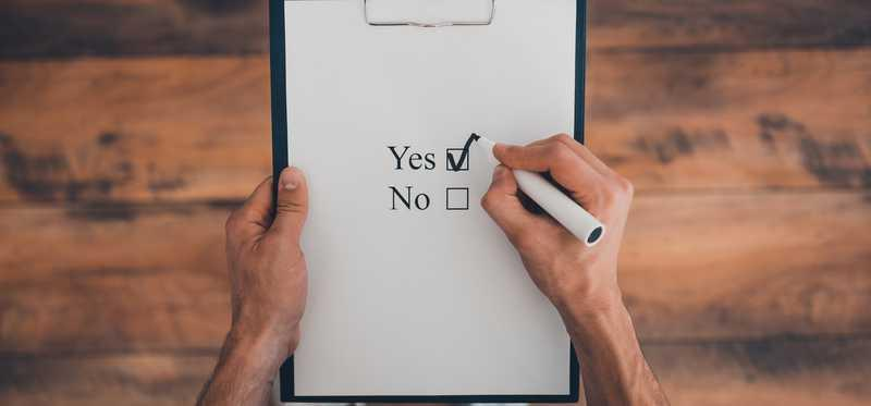 A piece of paper with yes and no check boxes and the yes box is checked