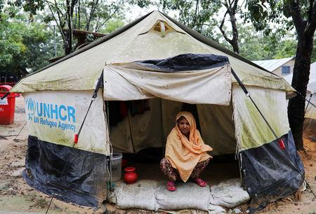 Shafika Khatun, who was from Ta Man Tha village in Myanmar's Maungdaw township, poses for a picture at her tent at the transit camp in Cox's Bazar, Bangladesh, October 14, 2018. REUTERS/Mohammad Ponir Hossain/Files