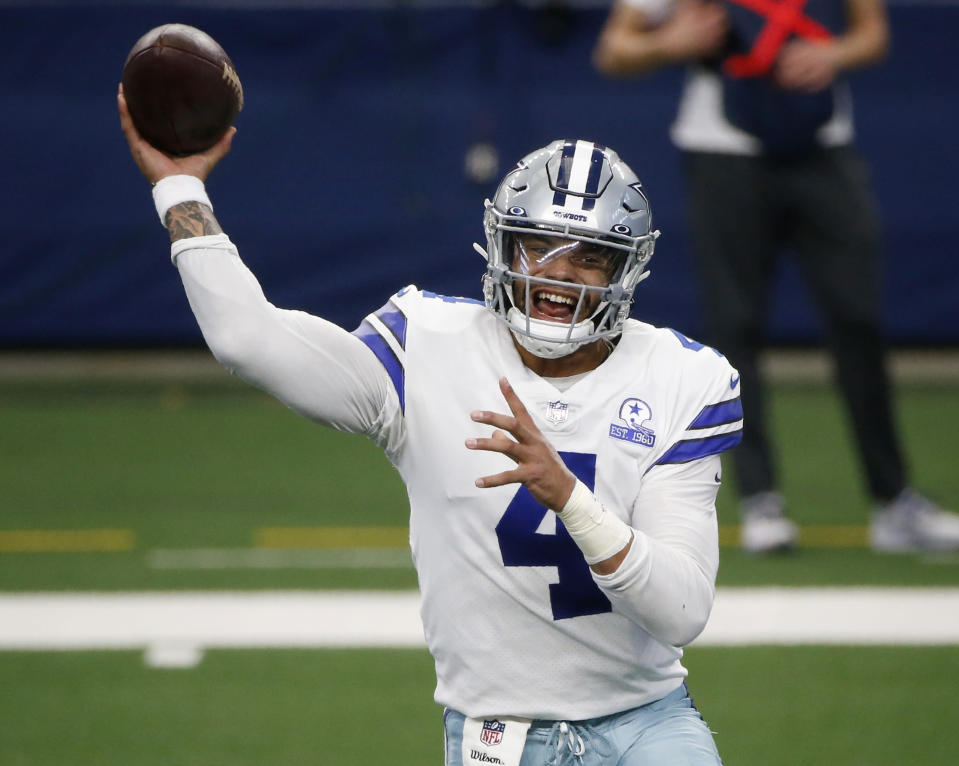 FILE - In this Oct. 11, 2020, file photo, Dallas Cowboys quarterback Dak Prescott throws a pass in the first half of an NFL football game against the New York Giants in Arlington, Texas. The Cowboys and Prescott have finally agreed on a contract two years after negotiations began with the star quarterback. The team the agreement was reached Monday, March 8, 2021, with further details to be announced. (AP Photo/Michael Ainsworth, File)