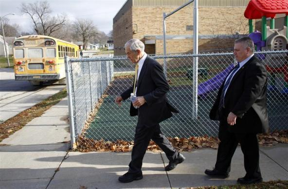 Ron Paul leaves a town hall meeting after speaking in Mount Pleasant, Iowa, December 21, 2011. (REUTERS/Joshua Lott)