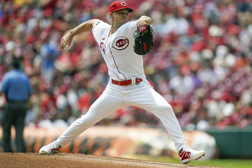 Cincinnati Reds' starting pitcher Sonny Gray (54) throws during the first inning of a baseball game against the St. Louis Cardinals in Cincinnati, Sunday, July 24, 2021. (AP Photo/Bryan Woolston)