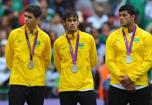 LONDON, ENGLAND - AUGUST 11: Oscar of Brazil, Neymar of Brazil and Hulk of Brazil look on with their silver medals during the medal ceremony for the Men's Football Final between Brazil and Mexico on Day 15 of the London 2012 Olympic Games at Wembley Stadium on August 11, 2012 in London, England. (Photo by Michael Regan/Getty Images)
