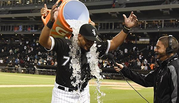 Jose Abreu gets an ice bath during a postgame interview on the field after hitting for the cycle for the first time in his career (Spox)