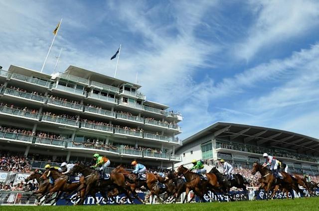 Organisers will attempt to reschedule the Epsom Derby for later in the year (AFP Photo/Glyn KIRK )