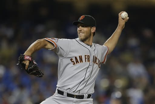 San Francisco Giants starting pitcher Madison Bumgarner throws against the Los Angeles Dodgers during the second inning of a baseball game in Los Angeles, Tuesday, April 2, 2013. (AP Photo/Jae C. Hong)