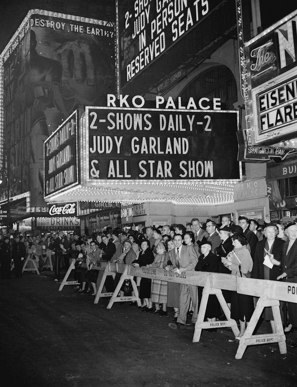 "<p>On October 16, Judy Garland begins her concert series at The Palace. Though her run was only supposed to be four weeks, she's such a hit that her stay is <a href=""https://backlots.net/2012/05/22/a-star-is-born-1954-and-judy-garlands-1951-palace-engagement-a-comparison/"" rel=""nofollow noopener"" target=""_blank"" data-ylk=""slk:extended to 19 weeks"" class=""link rapid-noclick-resp"">extended to 19 weeks</a>. </p><p><span class=""redactor-invisible-space""><em>RELATED: <a href=""https://www.goodhousekeeping.com/life/entertainment/g28307872/rare-photos-of-judy-garland/"" rel=""nofollow noopener"" target=""_blank"" data-ylk=""slk:40 Rare Photos of Judy Garland You've Probably Never Seen"" class=""link rapid-noclick-resp"">40 Rare Photos of Judy Garland You've Probably Never Seen</a></em></span></p>"