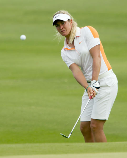 Suzann Pettersen of Norway, chips onto the first green during the third round of the LPGA Lotte Championship golf tournament at the Ko Olina Golf Club Friday, April 19, 2013, in Kapolei, Hawaii. (AP Photo/Eugene Tanner)