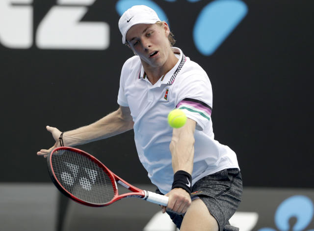 Canada's Denis Shapovalov makes a backhand return to Spain's Pablo Andujar during their first round match at the Australian Open tennis championships in Melbourne, Australia, Tuesday, Jan. 15, 2019. (AP Photo/Mark Schiefelbein)