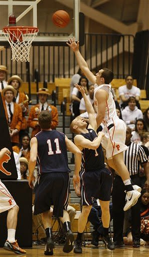Pennsylvania's Zack Rosen (1) fails to stop Princeton's Jimmy Sherburne (3) from scoring during the first half of an NCAA college basketball game in Princeton, N.J. on Tuesday, March 6, 2012. (AP Photo/Tim Larsen)