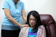 A relative of victims of a train derailment reacts at a hospital in Yilan, Taiwan October 22, 2018. REUTERS/Eason Lam