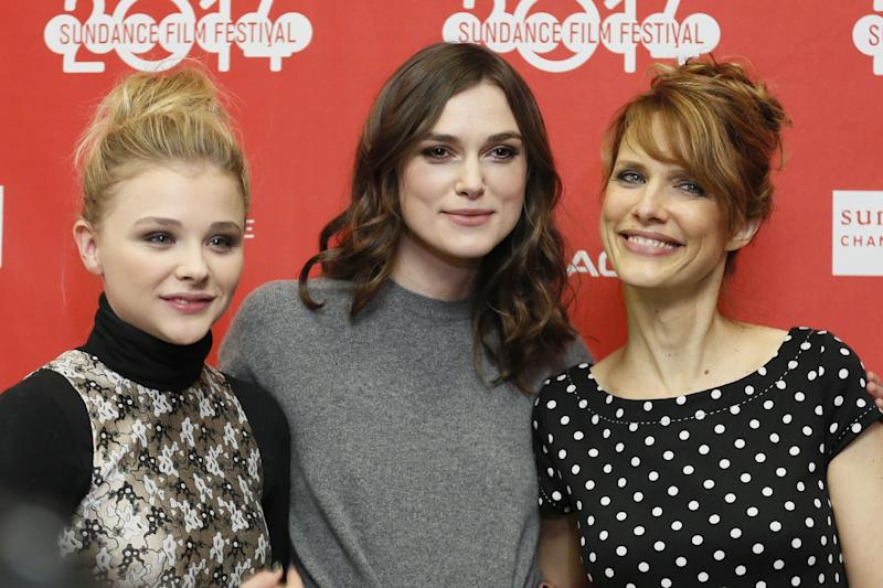 """Cast members Chloe Grace Moretz, left, and Keira Knightley, center, pose with director Lynn Shelton at the premiere of the film """"Laggies"""" during the 2014 Sundance Film Festival, on Friday, Jan. 17, 2014, in Park City, Utah. (Photo by Danny Moloshok/Invision/AP)"""