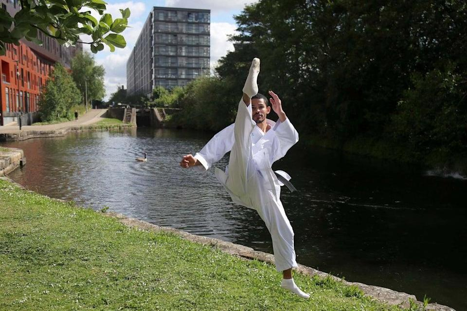 Team GB's karate athlete Jordan Thomas trains outside his apartment in Manchester (REUTERS)