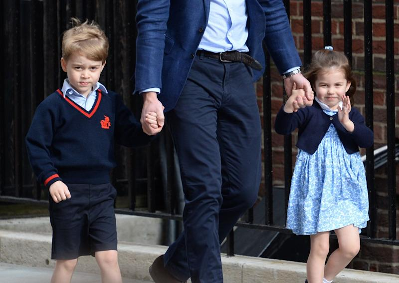 Prince George, William and Princess Charlotte arrive at St. Mary's Hospital.