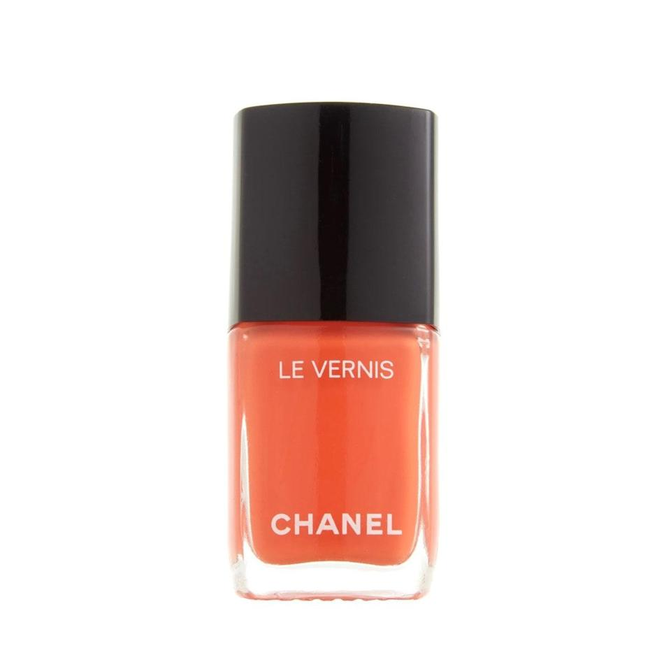 """Orange nail polish generally scares me, but with my summer tan, I decided to give it a go. If there's anyone that can make me like orange, it's Chanel. This polish strikes the right balance between sophisticated and fun, and looks great both on fingers and peeking out of sandals. As with all Chanel polishes, it goes on like a dream and has a beautiful, shiny finish. <em>—Bella Cacciatore, beauty writer</em> $28, Macy's. <a href=""""https://www.macys.com/shop/product/chanel-le-vernis-longwear-nail-colour-0.4-fl-oz.?ID=7981725&pla_country=US&CAGPSPN="""" rel=""""nofollow noopener"""" target=""""_blank"""" data-ylk=""""slk:Get it now!"""" class=""""link rapid-noclick-resp"""">Get it now!</a>"""