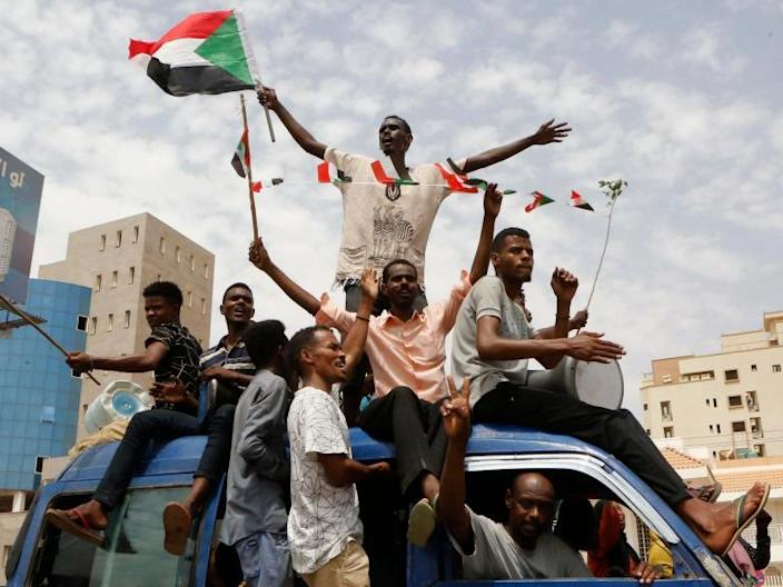 """Sudan's opposition and ruling military junta agreed to a political power-sharing deal early on Friday morning, designed to end months of political unrest that toppled the country's longtime dictator and left scores of civilians dead.Word of the deal sparked celebrations in the capital, Khartoum.""""It is a turning point that will usher in a new dawn in the country,"""" opposition Sudanese Congress Party leader Omar al-Degair was quoted as saying by state radio. Under the terms of the deal, Sudan's Transitional Military Council and the opposition Freedom and Change will contribute equally to a 10-person council that will rule over the country, with each side rotating in the leadership for three years or longer before the end of elections. They also agreed to a joint investigation of the 3 June massacre of peaceful opposition protesters at the hands of shadowy pro-regime militiamen.Lawyers for the two sides are writing up the agreement, which will be signed by both sides a few days after it is complete, Siddig Yousif, one of the civilian negotiators, told BBC World Service. """"This is the first step for building a democratic Sudan,"""" he said. The deal, brokered by the African Union, leaves a fragmented military backed by regional Arab dictatorships firmly entrenched. But it also dissolves the Transitional Military Council that has been in charge since the toppling of longtime ruler Omar al-Bashir, a military man. It comes after nearly eight months of protests that began in a rural enclave over bread price rises and culminated in a vast, peaceful movement led by a network of Sudanese lawyers, doctors, engineers and educators. Sudan has struggled to throw off the yoke of military rulers for decades. But civilian-led administrations were quickly toppled by the armed forces, who have dragged the country into repeated and disastrous civil wars. Mr Bashir's militarism cost the country its oil-rich south, which broke away and became the Republic of South Sudan in 2011. The country's """
