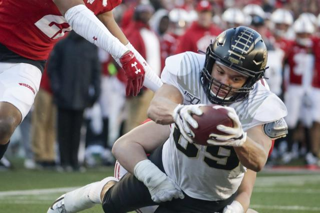 FILE - In this Nov. 23, 2019, file photo, Purdue's Brycen Hopkins dives into the end zone for a touchdown during the first half of an NCAA college football game against Wisconsin, in Madison, Wis. Hopkins was selected to The Associated Press All-Big Ten Conference team, Wednesday, Dec. 11, 2019. (AP Photo/Morry Gash, File)