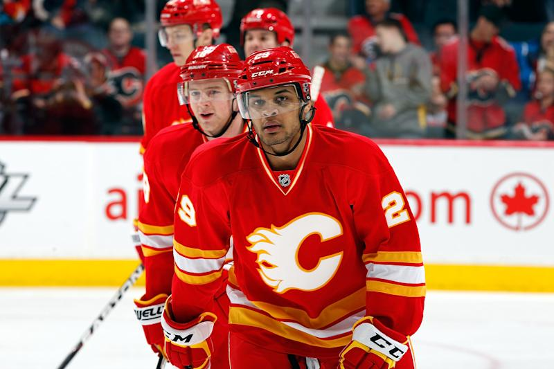 CALGARY, CANADA - APRIL 7: Akim Aliu #29 of the Calgary Flames skates to the bench after socring his first NHL goal against the Anaheim Ducks on April 7, 2012 at the Scotiabank Saddledome in Calgary, Alberta, Canada. (Photo by Gerry Thomas/NHLI via Getty Images)