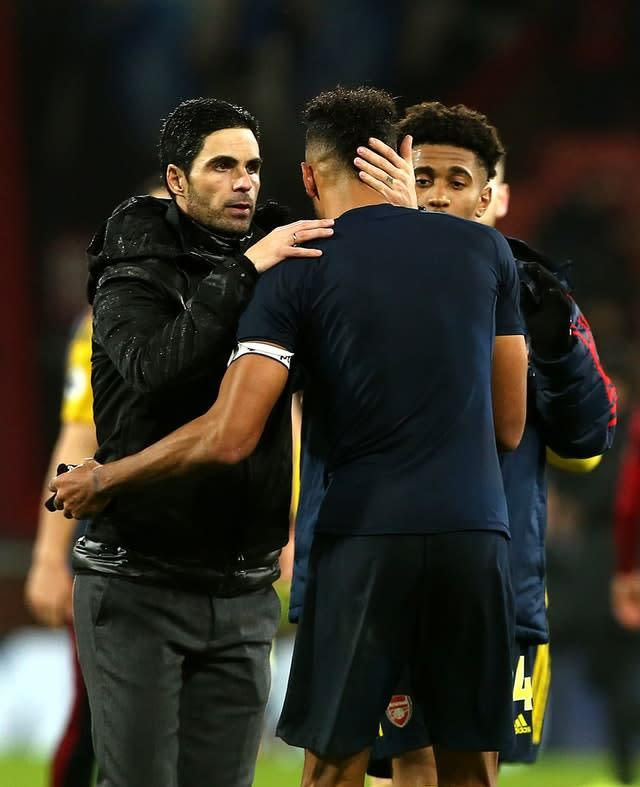 Mikel Arteta, left, embraces Pierre-Emerick Aubameyang after Arsenal's draw at Bournemouth (Mark Kerton/PA)