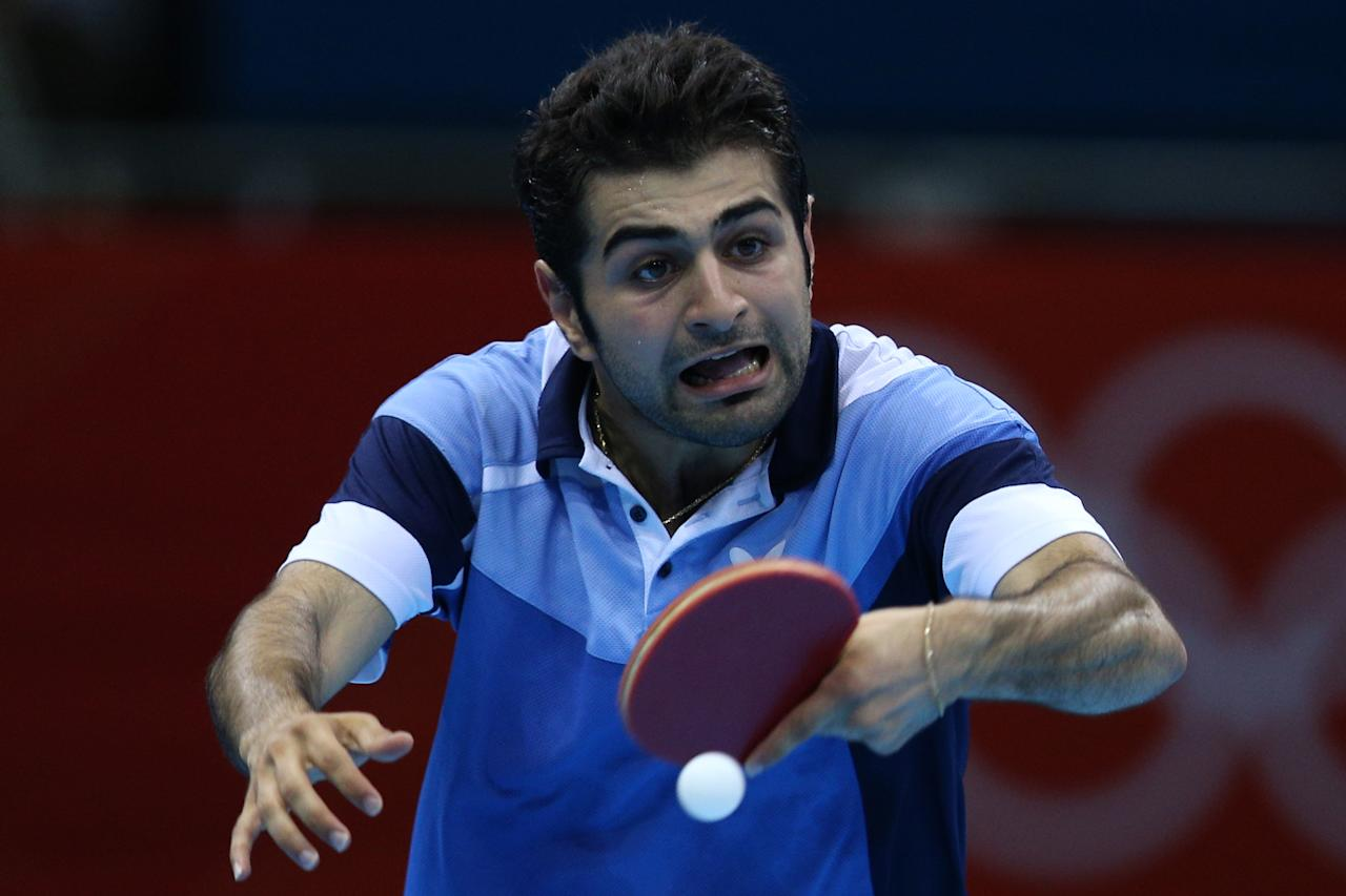 LONDON, ENGLAND - JULY 29:  Noshad Alamiyan of Iran plays a backhand in his Men's Singles Table Tennis second round match against Peng Tang of Hong Kong on Day 2 of the London 2012 Olympic Games at ExCeL on July 29, 2012 in London, England.  (Photo by Feng Li/Getty Images)