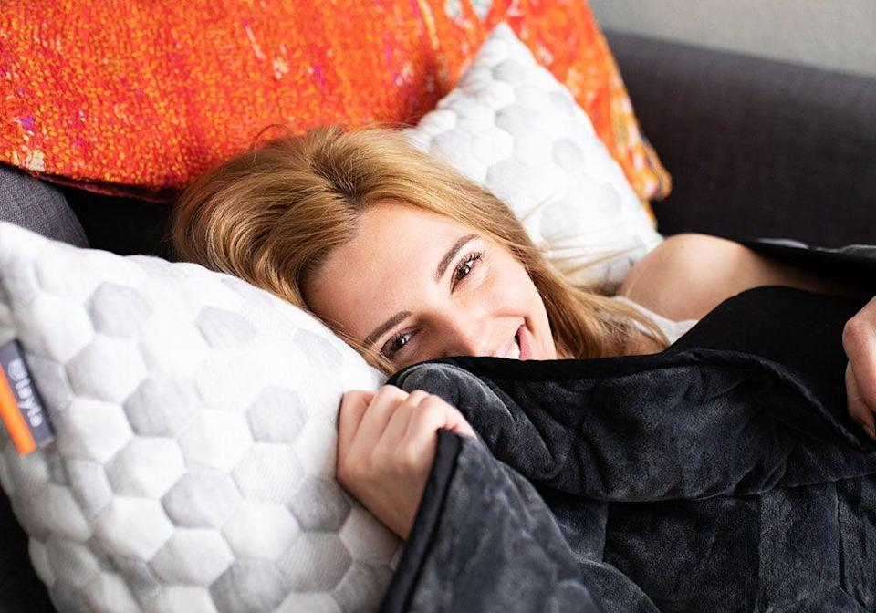 """<h3>Layla Sleep Weighted Blanket</h3><br>Layla's weighted blanket combines a 300 thread-count 100%-cotton cover, soft fleecey top layer, and padded glass-bead filling with all-encompassing sizing options that run from twin to queen and king. <br><br><strong>The hype:</strong> 4.7 out of 5 stars and 760 reviews on <a href=""""https://laylasleep.com/product/layla-weighted-blanket/"""" rel=""""nofollow noopener"""" target=""""_blank"""" data-ylk=""""slk:Layla Sleep"""" class=""""link rapid-noclick-resp"""">Layla Sleep</a><br><br><strong>What they're saying:</strong> """"A weight off my mind!🤓 I love, love, love my new weighted blanket! The first night I slipped under it, I felt the day's problems lift from my mind. I immediately felt relaxed and secure. I've been sleeping very soundly and wake up feeling relaxed. I love it so much, I bought a twin size to keep on the couch so I can use it when I watch TV or read. This is a great invention and this particular blanket is very well made. The soft side is SO soft. I'm very happy with it."""" <em>– Bonnie, Layla Sleep reviewer</em><br><br><strong>Layla Sleep</strong> Weighted Blanket, $, available at <a href=""""https://go.skimresources.com/?id=30283X879131&url=https%3A%2F%2Flaylasleep.com%2Fproduct%2Flayla-weighted-blanket%2F"""" rel=""""nofollow noopener"""" target=""""_blank"""" data-ylk=""""slk:Layla Sleep"""" class=""""link rapid-noclick-resp"""">Layla Sleep</a>"""