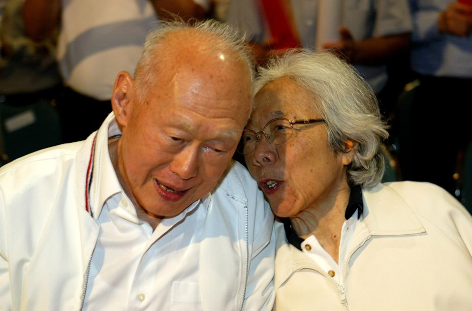 Singapore's Minister Mentor Lee Kuan Yew, left, shares a light moment with his wife, Kwa Geok Choo during the Labour Day Rally, Monday May 1, 2006  in Singapore. Singapore's opposition parties denied the ruling party, the People's Action Party, led by Lee's son, Prime Minister Lee Hsien Loong, a walkover victory in the May 6 elections by contesting more than half the seats in Parliament for the first time in nearly two decades. Even with greater opposition participation in the poll, the PAP or People's Action Party which has ruled Singapore uninterrupted since its separation from Malaysia in 1965, is likely to win an overwhelming majority.   (AP Photo/Wong Maye-E)