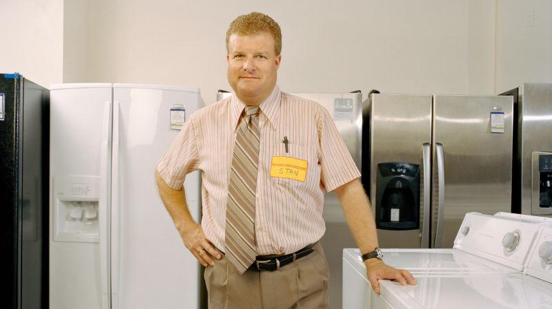 A stressed-looking appliance salesman
