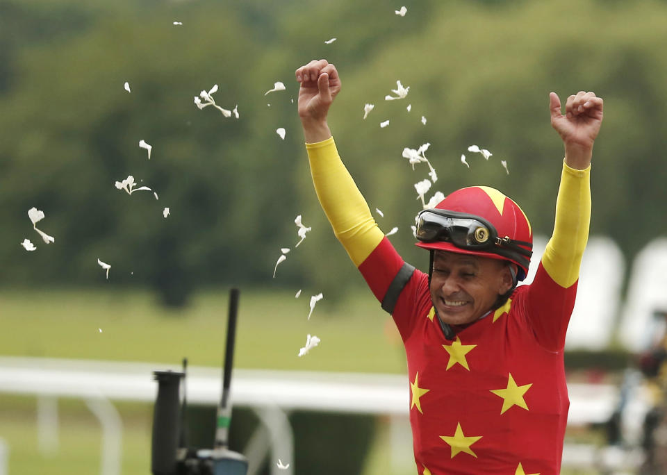 Jockey Mike Smith reacts after guiding Justify to win the Triple Crown at the 150th running of the Belmont Stakes horse race, Saturday, June 9, 2018, in Elmont, N.Y. (AP Photo/Andres Kudacki)