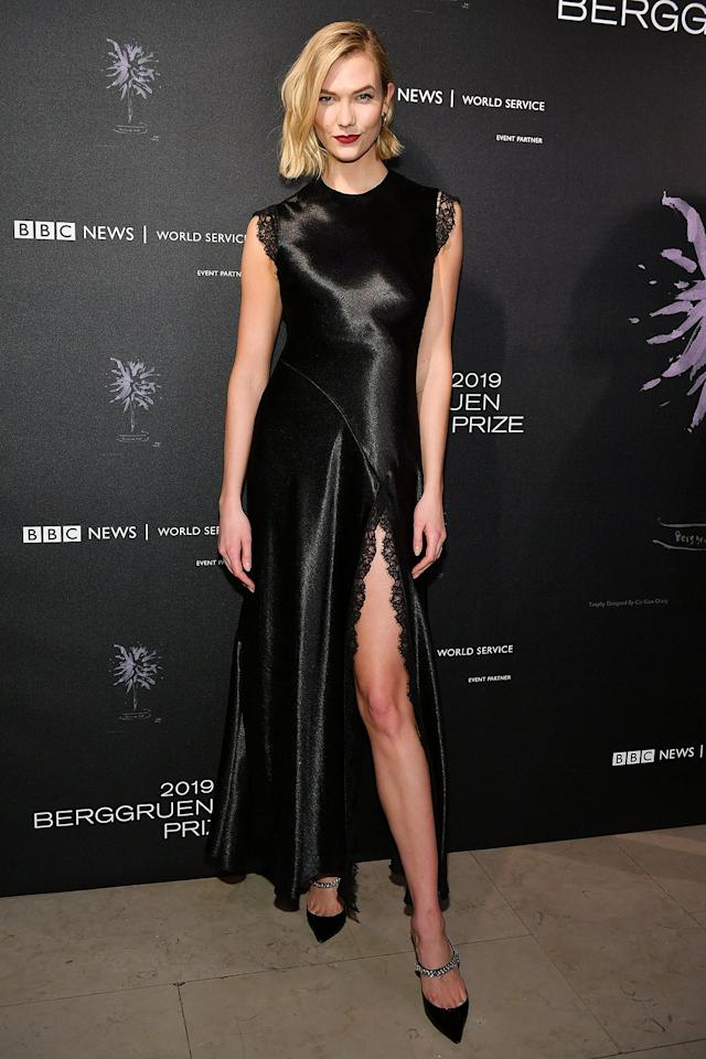 """Going all-out for New Year's Eve? Take a cue from Karlie Kloss, who picks a dress that's low maintenance (the bias cut and high neck) but still sexy (that lace-trimmed slit) and adds fun shoes.  <strong>Get the look!</strong>  ASOS DESIGN High Neck Washed Satin Midi, $79; <a href=""""https://click.linksynergy.com/deeplink?id=93xLBvPhAeE&mid=35719&murl=https%3A%2F%2Fwww.asos.com%2Fus%2Fasos-design%2Fasos-design-high-neck-washed-satin-midi-with-cowl-back%2Fprd%2F12806690&u1=PEO%2CLoveHerOutfit%3AHolidayPartyEdition%2Cllieberman1271%2CUnc%2CGal%2C6723569%2C201912%2CI"""" target=""""_blank"""" rel=""""nofollow"""">asos.com</a>  REISS Aideen Lace Combo Dress, $230 (orig. $425); <a href=""""https://click.linksynergy.com/deeplink?id=93xLBvPhAeE&mid=13867&murl=https%3A%2F%2Fwww.bloomingdales.com%2Fshop%2Fproduct%2Freiss-aideen-lace-combo-dress-100-exclusive%3FID%3D3422711&u1=PEO%2CLoveHerOutfit%3AHolidayPartyEdition%2Cllieberman1271%2CUnc%2CGal%2C6723569%2C201912%2CI"""" target=""""_blank"""" rel=""""nofollow"""">bloomingdales.com</a>  Jewel Badgley Mischka Stella, $109; <a href=""""http://www.anrdoezrs.net/links/8029122/type/dlg/sid/PEO,LoveHerOutfit:HolidayPartyEdition,llieberman1271,Unc,Gal,6723569,201912,I/https://www.zappos.com/p/jewel-badgley-mischka-stella-black/product/9258969/color/3"""" target=""""_blank"""" rel=""""nofollow"""">zappos.com</a>  Kurt Geiger Women's Duke Embellished High-Heel Mules, $175; <a href=""""https://click.linksynergy.com/deeplink?id=93xLBvPhAeE&mid=13867&murl=https%3A%2F%2Fwww.bloomingdales.com%2Fshop%2Fproduct%2Fkurt-geiger-womens-duke-embellished-high-heel-mules%3FID%3D351943&u1=PEO%2CLoveHerOutfit%3AHolidayPartyEdition%2Cllieberman1271%2CUnc%2CGal%2C6723569%2C201912%2CI"""" target=""""_blank"""" rel=""""nofollow"""">bloomingdales.com</a>"""