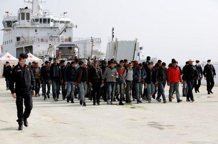 Migrants disembarks from Dattilo coast guard vessel in the Sicilian harbour of Augusta