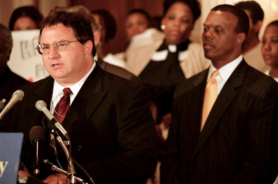 IMAGE: John J. DiIulio Jr., director of the White House Office of Faith-Based and Community Initiatives, at a rally in support of a bill in 2001. (Scott J. Ferrell / CQ-Roll Call via Getty Images file)