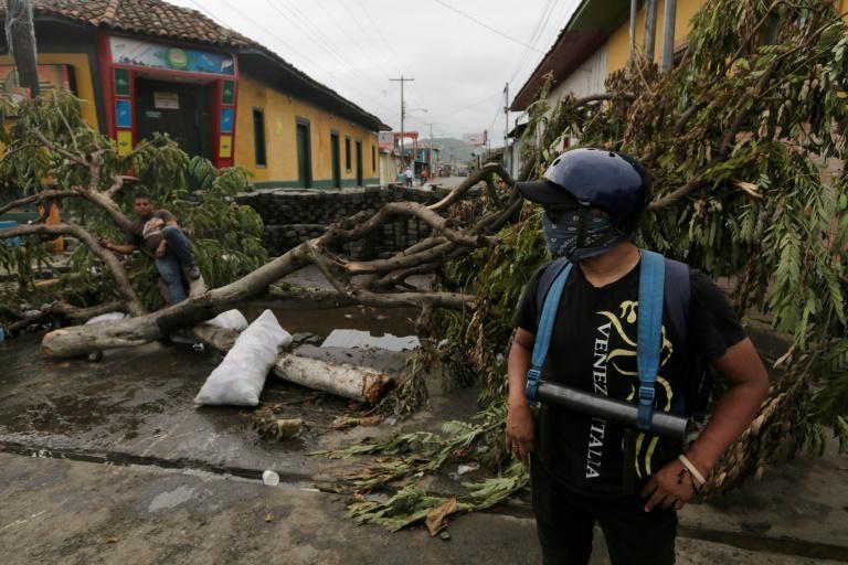 Anti-government demonstrators guard an improvised barricade in the town of Masaya, 35 km from Managua on June 5, 2018