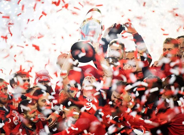 <p>It's only fitting that TFC capped off the best season in MLS history by hoisting the trophy in front of their home fans. (Nathan Denette/CP) </p>