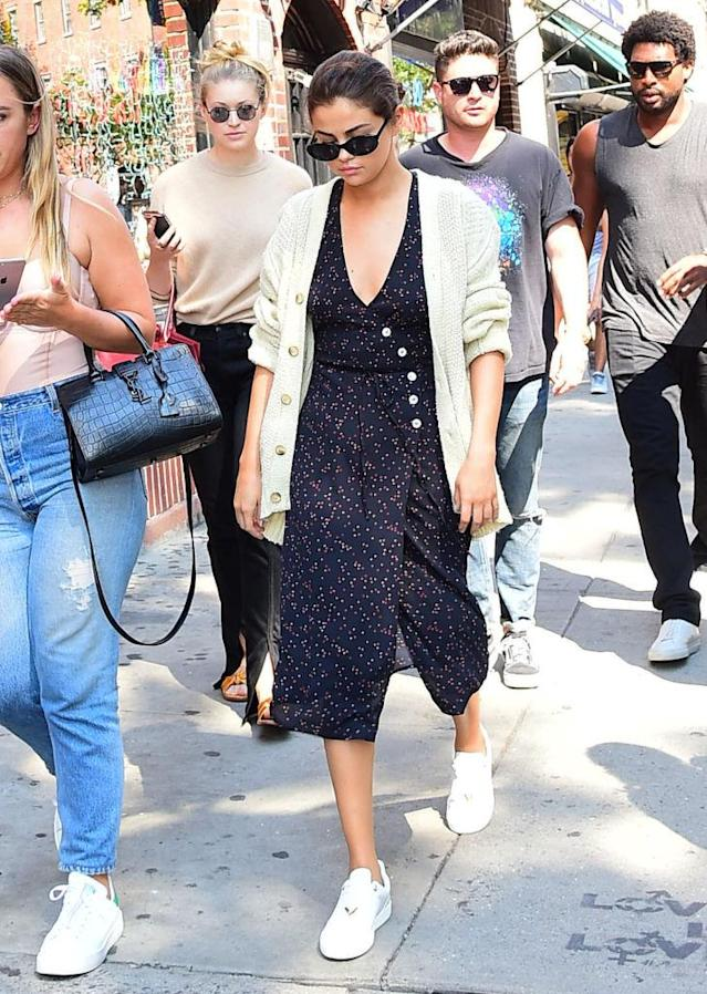 "<p>Gomez immediately stepped into fall with Tuesday's look, which consisted of a short-sleeve <a href=""https://www.instagram.com/rouje/?hl=en"" rel=""nofollow noopener"" target=""_blank"" data-ylk=""slk:Rouje"" class=""link rapid-noclick-resp"">Rouje</a> dress with a cardigan over it. (Photo: Josiah Kamau/BuzzFoto via Getty Images) </p>"