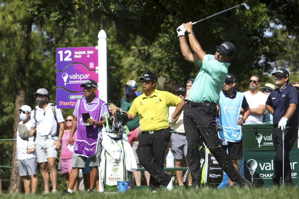 Phil Mickelson watches a shot on the 12th hole during the second round of the PGA's Valspar Championship golf touranment at Innisbrook Golf Resort in Palm Harbor, Fla., Friday, April 30, 2021. (Ivy Ceballo/Tampa Bay Times via AP)
