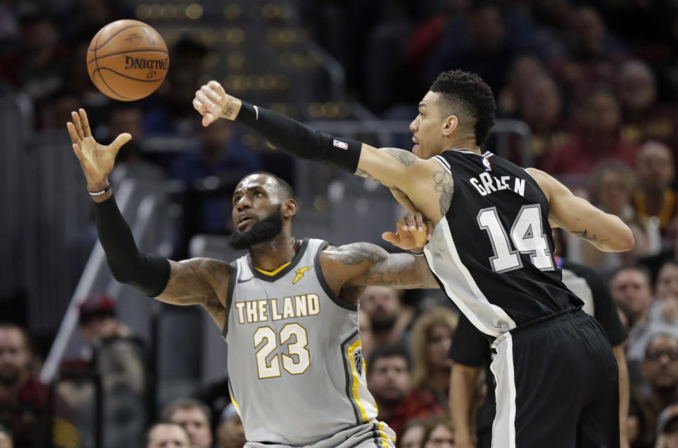 LeBron James and Danny Green battle for the ball. (AP)