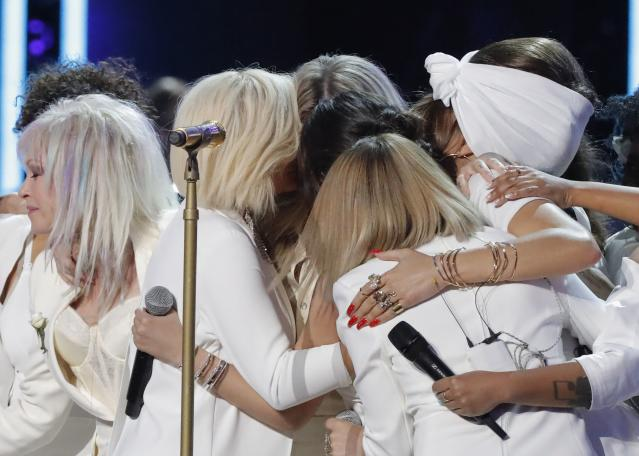 "Kesha (rear, center) is embraced by her fellow singers after performing ""Praying."" (Photo: REUTERS/Lucas Jackson)"