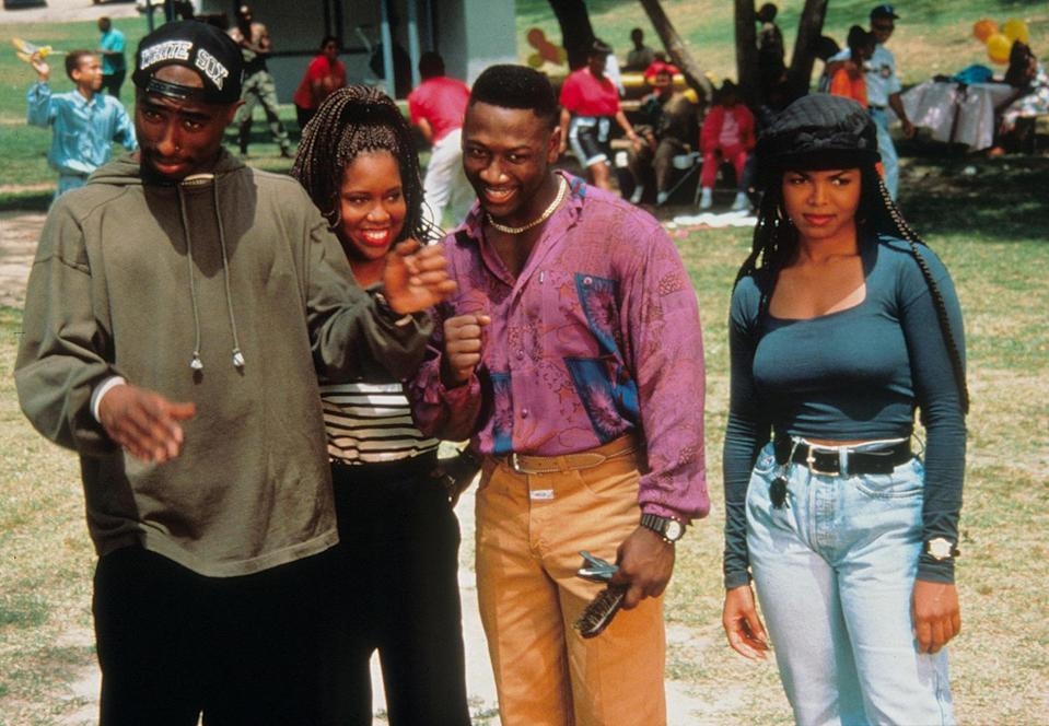 """<p>In 1993, King played Iesha in another John Singleton classic, <em>Poetic Justice</em>. Singleton tapped Tupac Shakur and Janet Jackson, already huge stars, as romantic leads alongside King and Joe Torry, who played boyfriend and girlfriend in the romantic drama.</p> <p>The film debuted at No. 1 at the box office its opening weekend and grossed more than $27 million domestically, according to <a href=""""https://www.revolt.tv/2018/7/23/20823215/25-years-later-10-reasons-why-poetic-justice-is-an-undisputed-classic"""" rel=""""nofollow noopener"""" target=""""_blank"""" data-ylk=""""slk:Revolt"""" class=""""link rapid-noclick-resp""""><em>Revolt</em></a>. </p>"""
