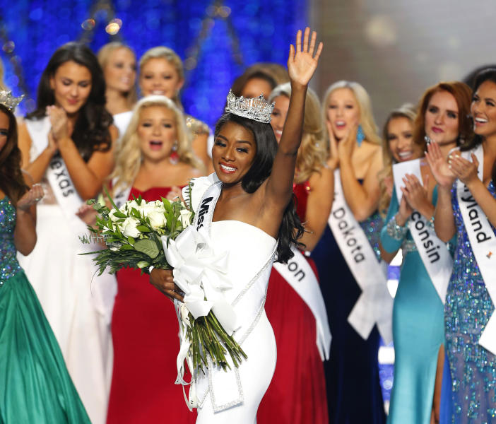 FILE - In this Sept. 9, 2018 file photo, Miss New York Nia Franklin reacts after being named Miss America 2019 in Atlantic City, N.J. The Miss America Organization says this year's pageant will be held at the Mohegan Sun Connecticut in Uncasville, Conn. It will be broadcast on NBC Dec. 19, in a switch from recent broadcaster ABC. (AP Photo/Noah K. Murray, File)