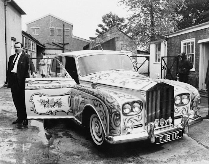 Anthony stands next to John Lennon's custom-built Rolls-Royce Phantom V in 1967: Getty