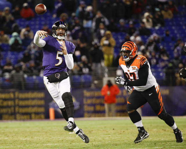 Ravens quarterback Joe Flacco throws under pressure from Bengals defensive tackle Geno Atkins in the second half. (AP)