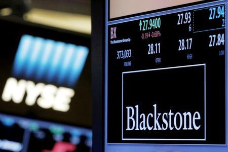FILE PHOTO: The ticker and trading information for Blackstone Group is displayed at the post where it is traded on the floor of the New York Stock Exchange