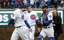 Chicago Cubs starting pitcher Kyle Hendricks, center, celebrates with Anthony Rizzo, left, and Willson Contreras, right, after defeating the St. Louis Cardinals in a baseball game, Friday, May 3, 2019, in Chicago. (AP Photo/Kamil Krzaczynski)