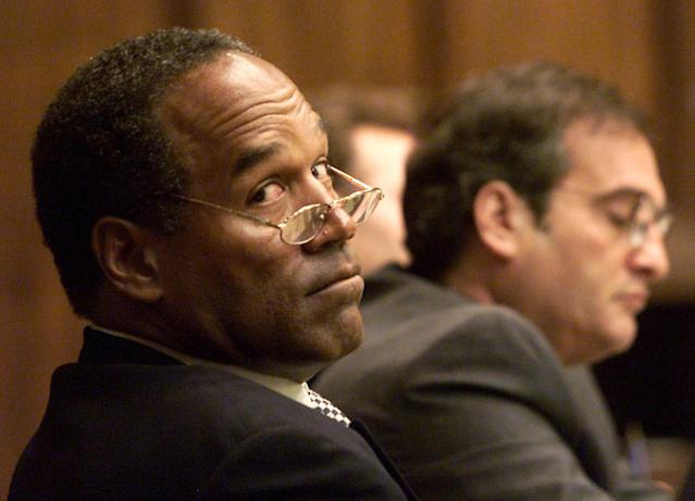 "<p>O.J. Simpson looks back into the courtroom gallery as co-defense council Lee Cohn (R) watches during the fourth day of jury selection in his ""road rage"" trial in Miami, Fla., on Oct. 12, 2001. Simpson is on trial for allegedly attacking a Miami motorist in Dec. of 2000. If found guilty, Simpson faces up to 16 years in prison. (Photo: Pool/Wilfredo Lee/Reuters) </p>"