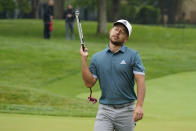 Xander Schauffele reacts after missing a putt on the 13th hole during the first round of the Memorial golf tournament, Thursday, June 3, 2021, in Dublin, Ohio. (AP Photo/Darron Cummings)