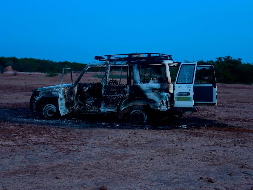 The wreckage of the car where six French aid workers, their local guide and the driver were killed by unidentified gunmen riding motorcycles in an area of southwestern Niger: AFP via Getty Images