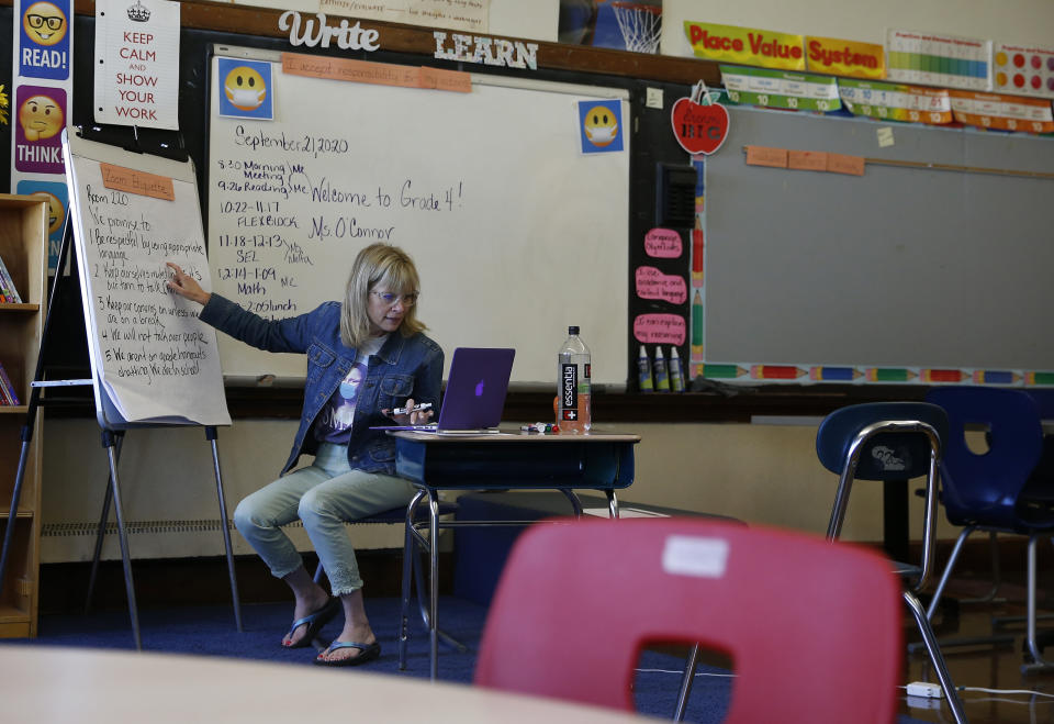 BOSTON, MA - SEPTEMBER 21: Cheryl O'Connor goes over a list of rules for how her 4th grade class should interact over zoom during the first day of school at Russell Elementary in Boston's Dorchester on Sept. 21, 2020. Boston Public Schools reopened for remote learning, with many teachers teaching from their classrooms through Zoom. (Photo by Jessica Rinaldi/The Boston Globe via Getty Images)