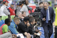 FILE - In this Oct. 6, 2019, file photo, Seattle Sounders head coach Brian Schmetzer, right, talks to his bench during the second half of an MLS soccer match against Minnesota United in Seattle. The MLS soccer team announced Monday, Jan. 25, 2021, that the team and Schmetzer had reached agreement on a multiyear contract extension. (AP Photo/Ted S. Warren, File)