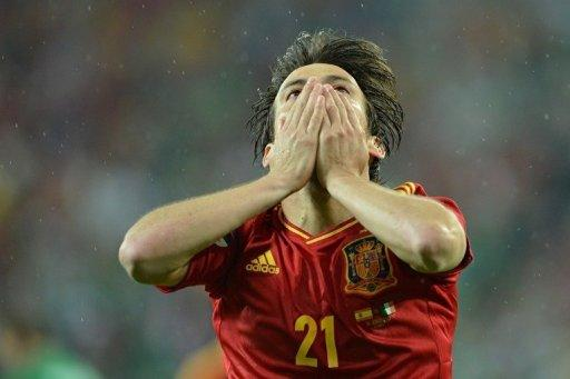 Spanish midfielder David Silva celebrates after scoring a goal during the Euro 2012 championships football match Spain vs Republic of Ireland at the Gdansk Arena. A double by Fernando Torres inspired defending champions Spain to a 4-0 thrashing of Ireland on Thursday in their Euro 2012 Group C match and ended Irish hopes of qualifying for the quarter-finals