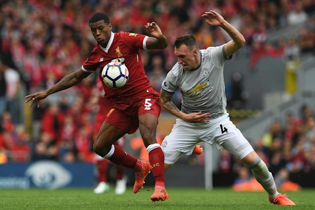 Liverpool midfielder Georginio Wijnaldum (left) vies with Manchester United's Phil Jones during their English Premier League match at Anfield in Liverpool on October 14, 2017 (AFP Photo/Paul ELLIS)
