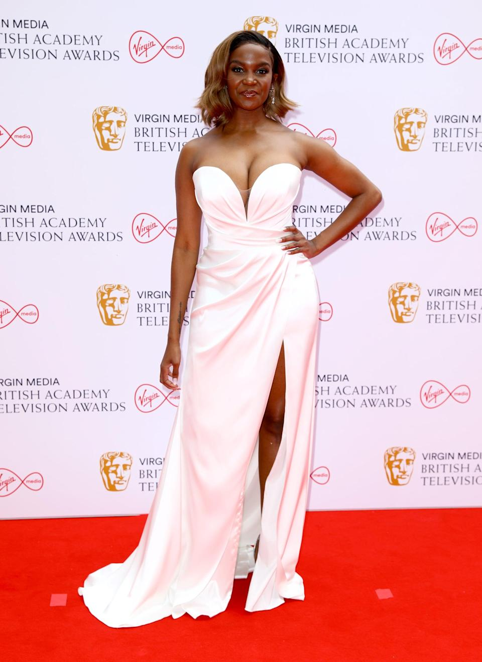 <p>Oti Mabuse wore a Suzanne Neville London bridal gown.</p>